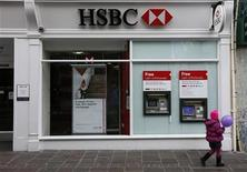 A girl holding a balloon walks past a bank branch of HSBC in St Helier, Jersey November 11, 2012. REUTERS/Stefan Wermuth (JERSEY - Tags: BUSINESS)