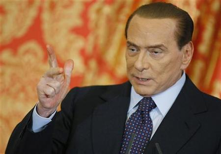 Italy's former Prime Minister Silvio Berlusconi gestures as he speaks during a news conference at Villa Gernetto in Gerno near Milan October 27, 2012. Berlusconi appeared to have done an about-face on Saturday, vowing to stay in front-line Italian politics after a Milan court sentenced him to four years in jail for tax fraud related to his media empire. REUTERS/Alessandro Garofalo (ITALY - Tags: POLITICS CRIME LAW)