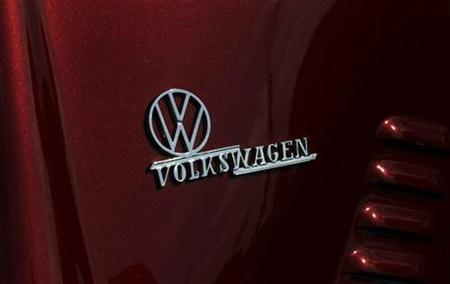 The VW logo is pictured on a Beetle car during the 29th annual ''MaiKaeferTreffen'' (May Beetle meeting) in Hanover, May 1, 2012. Around 3500 air-cooled Volkswagen vehicles took part in this event hosted by the Maikaeferteam Hannover car association. REUTERS/Tobias Schwarz (GERMANY - Tags: TRANSPORT SOCIETY)