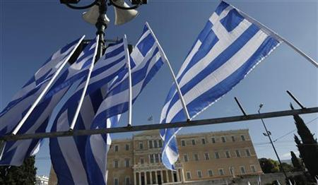 Greek flags fly in front of the parliament building during a rally in central Athens November 6, 2012. Hundreds of thousands of Greeks began a crippling 48-hour strike on Tuesday to protest against a new round of wage and pension cuts that parliament is expected to approve narrowly a day later. REUTERS/Yorgos Karahalis (GREECE - Tags: POLITICS BUSINESS EMPLOYMENT CIVIL UNREST)