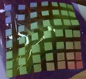 A stretchable material containing squared stiff islands for the protection of brittle electronic devices is pictured in this handout photo. Studart/Handout