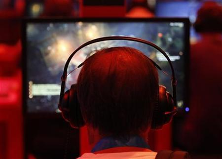 Visitors play ''Diablo'' during the Gamescom 2012 fair in Cologne August 16, 2012. REUTERS/Ina Fassbender/files