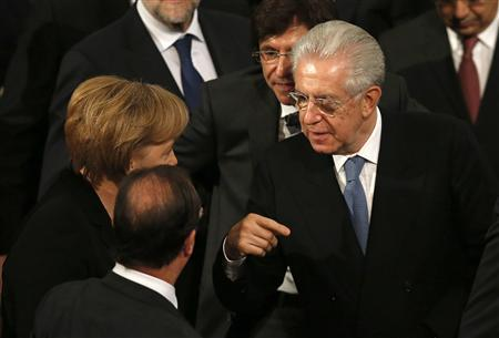 Italy's Monti warns against populism as Berluscon...