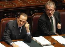 L'ex premier Silvio Berlusconi e il segretario della Lega Nord Roberto Maroni. REUTERS/Max Rossi