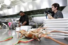 "Contestant Jeffrey Williams is filmed as he cooks during the taping of ""Epic Chef"" Episode 5: Epic Chicken at the Belasco theatre in Los Angeles, California October 17, 2012. REUTERS/Mario Anzuoni"