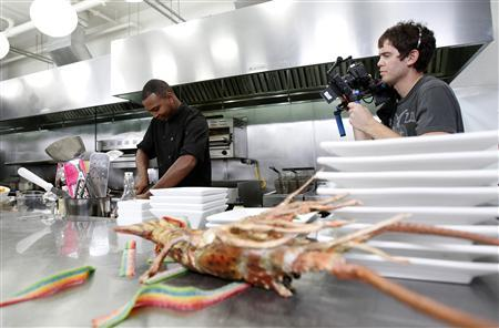 Contestant Jeffrey Williams is filmed as he cooks during the taping of ''Epic Chef'' Episode 5: Epic Chicken at the Belasco theatre in Los Angeles, California October 17, 2012. REUTERS/Mario Anzuoni