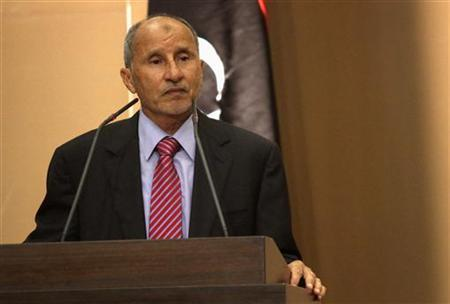 Mustafa Abdel Jalil, chairman of the Libya's National Transitional Council (NTC) speaks during the handover ceremony of power to the national congress in Tripoli, August 8, 2012. REUTERS/Esam Al-Fetori/Files