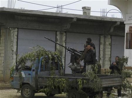 Free Syrian Army fighters are seen at Houla, near Homs, December 10, 2012. REUTERS/Misra Al-Misri/Shaam News Network/Handout