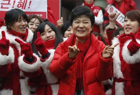 South Korea's ruling Saenuri Party's presidential candidate Park Geun-Hye (C) dances with election campaigners of the party, during her campaign in Seoul December 7, 2012. REUTERS/Lee Jae-Won