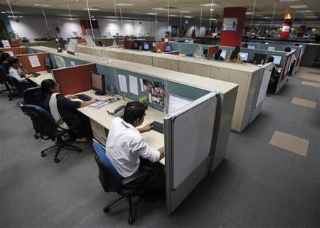 Employees work on the floor of an outsourcing company in Mumbai March 19, 2012. REUTERS/Vivek Prakash/Files