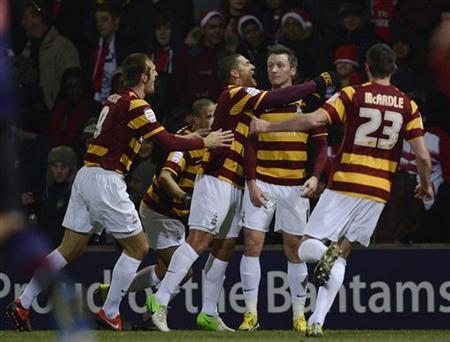 Bradford City's Garry Thompson (2nd R) celebrates scoring with teammates against Arsenal during their English League Cup soccer match in Bradford, northern England December 11, 2012. REUTERS/Nigel Roddis