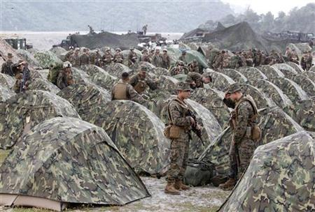 U.S marines look for their tents as they arrive at Crow Valley for the Philippines-U.S. amphibious landing exercise dubbed Phiblex 2013 in Tarlac, north of Manila, October 9, 2012. REUTERS/Cheryl Ravelo/Files