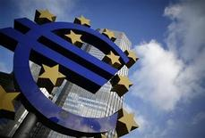 The Euro currency sign is seen in front of the European Central Bank (ECB) headquarters in Frankfurt December 6, 2012. The European Central Bank held interest rates at a record low of 0.75 percent on Thursday, leaving investors to shift their attention to new economic forecasts for clues about possible cuts next year. REUTERS/Lisi Niesner (GERMANY - Tags: BUSINESS)