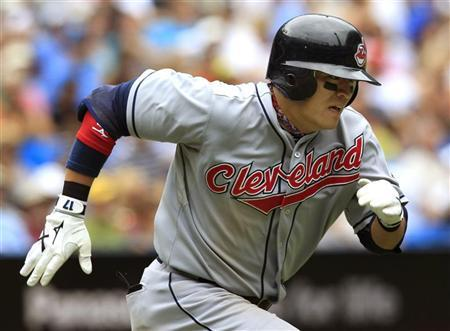 Cleveland Indians batter Choo Shin-soo of South korea runs to first base on a ground ball out against the Toronto Blue Jays during the ninth inning of their MLB American League baseball game in Toronto July 31, 2010. REUTERS/ Mike Cassese
