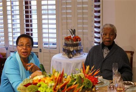 Former South African president Nelson Mandela (R) and his wife Graca Machel look on as he celebrates his birthday at his house in Qunu, Eastern Cape July 18, 2012. REUTERS/Siphiwe Sibeko/Files