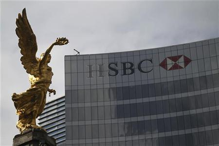 The Angel of Independence is seen near a HSBC building in Mexico City, December 11, 2012. REUTERS/Edgard Garrido