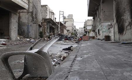 A damaged plastic chair is seen among rubble on a damaged street in Aleppo's al-Amereya district December 11, 2012. REUTERS/Aaref Hretani