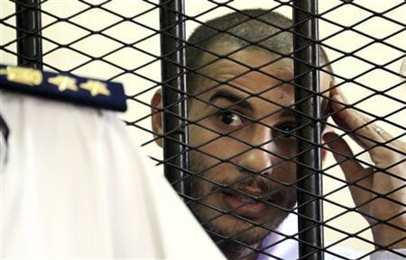 Computer science graduate Alber Saber, 27, is seen inside a cage during his trial in Cairo September 26, 2012. REUTERS/Mohamed Abd El Ghany/Files