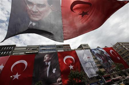 Halaskargazi street is decorated with huge Turkish flags and portraits of Mustafa Kemal Ataturk, ahead of Youth and Sports Day in central Istanbul May 16, 2012. REUTERS/Murad Sezer