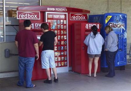 Customers rent DVD movies from a redbox video kiosk in Burbank, California, May 8, 2011. REUTERS/Fred Prouser/Files