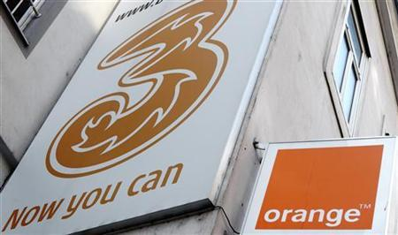The logos of ''Orange'' and ''3'' are pictured outside a telecommunications store in Vienna February 3, 2012. REUTERS/Heinz-Peter Bader