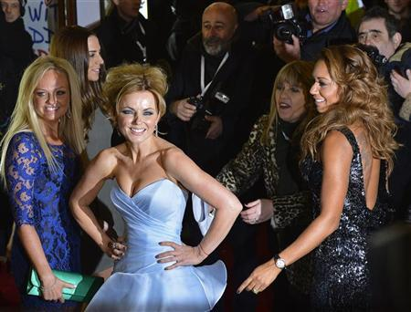 Spice Girl members Melanie Brown (R), Geri Halliwell (2nd L) and Emma Bunton (L) arrive for the premiere of the musical ''Viva Forever!'', based on the music of the Spice Girls, in central London December 11, 2012. REUTERS/Toby Melville