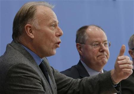 Top candidates for the 2013 German general elections Peer Steinbrueck (R) of the German Social Democratic Party (SPD) and German environmental Green Party (Die Gruenen) Juergen Trittin address a news conference in Berlin December 12, 2012. REUTERS/Tobias Schwarz (GERMANY - Tags: POLITICS)