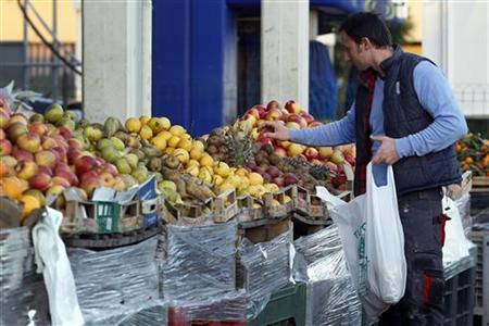 A customer shops for fruits in a market near Rome December 12, 2012. REUTERS/Giampiero Sposito