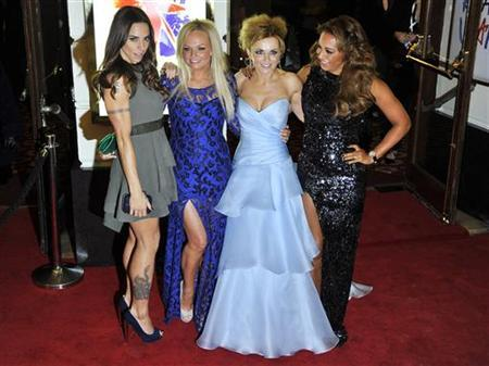 Spice Girl members Melanie Brown (R-L), Geri Halliwell, Emma Bunton and Melanie Chisholm arrive for the premiere of the musical ''Viva Forever!'', based on the music of the Spice Girls, in central London December 11, 2012. REUTERS/Toby Melville