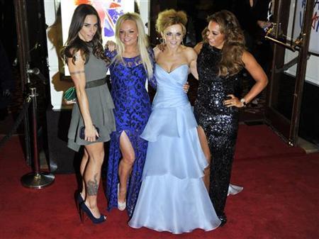 Spice Girl members Melanie Brown (R-L), Geri Halliwell, Emma Bunton and Melanie Chisholm arrive for the premiere of the musical ''Viva Forever!'', based on the music of the Spice Girls, in central London December 11, 2012. REUTERS/Toby Melville