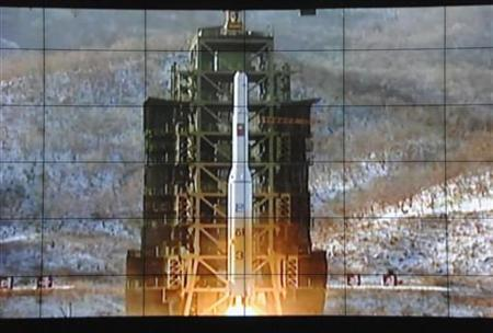A screen shows a rocket being launched from a launch pad at the West Sea Satellite Launch Site, at North Korea's satellite control centre in Cholsan county, North Pyongan province, in this photo released by Kyodo December 12, 2012. North Korea successfully launched a rocket on Wednesday, boosting the credentials of its new leader and stepping up the threat the isolated and impoverished state poses to opponents. REUTERS/Kyodo