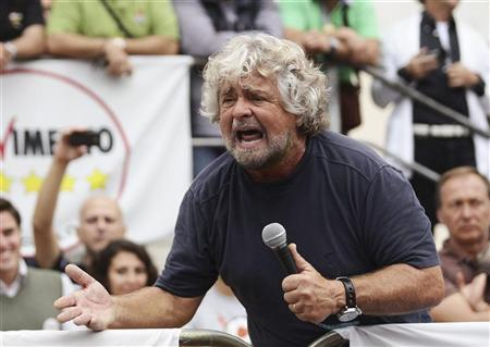 Five-Star Movement activist and comedian Beppe Grillo speaks during a rally in support of the party's candidate Giancarlo Cancelleri, in the Sicily town of Termini Imerese October 22, 2012. REUTERS/Massimo Barbanera