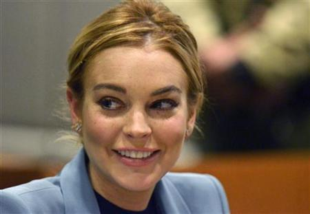 Actress Lindsay Lohan smiles during a progress report hearing in her DUI case at Airport Branch Courthouse in Los Angeles, California, March 29, 2012. REUTERS/Joe Klamar