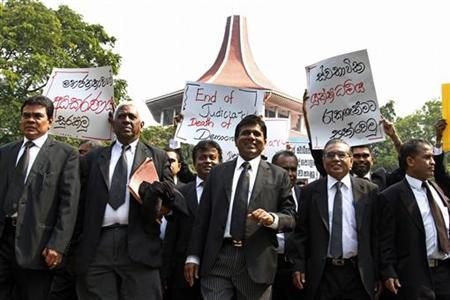 Lawyers march as they boycott court proceedings during a protest in front of the Supreme Courts in Colombo December 12, 2012. REUTERS/Stringer