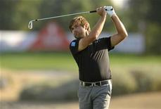 Robert Rock of England plays a shot on the 17th hole during the final round of the Abu Dhabi Championship at the Abu Dhabi Golf Club January 29, 2012. REUTERS/Philip Brown