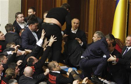 Parliament members scuffle over regulations in forming factions during the first session of the newly-elected Ukrainian parliament in Kiev December 12, 2012. REUTERS/Anatolii Stepanov