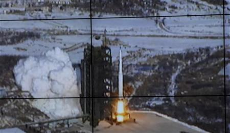 A screen shows the Unha-3 (Milky Way 3) rocket being launched from a launch pad at the North Korea's West Sea Satellite Launch Site, at the satellite control centre in Cholsan county, North Pyongan province in this picture released by the official KCNA news agency in Pyongyang December 12, 2012. REUTERS/KCNA