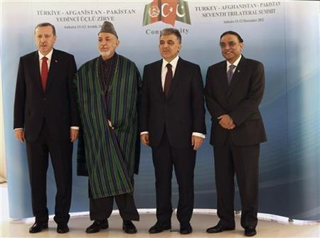 Presidents Hamid Karzai of Afghanistan (2nd L), Abdullah Gul of Turkey (2nd R), Asif Ali Zardari of Pakistan (R) and Turkey's Prime Minister Tayyip Erdogan (L) pose at the Presidential Palace of Cankaya in Ankara December 12, 2012. REUTERS/Burhan Ozbilici/Pool