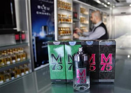 A vendor displays perfume bottles called M75 at his shop in Gaza City December 12, 2012. REUTERS/Ahmed Zakot