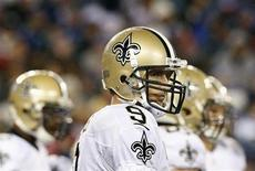 New Orleans Saints' quarterback Drew Brees stands in the rain between plays in the fourth quarter of the Saints' loss to the New York Giants, during their NFL football game in East Rutherford, New Jersey, December 9, 2012. REUTERS/Mike Segar