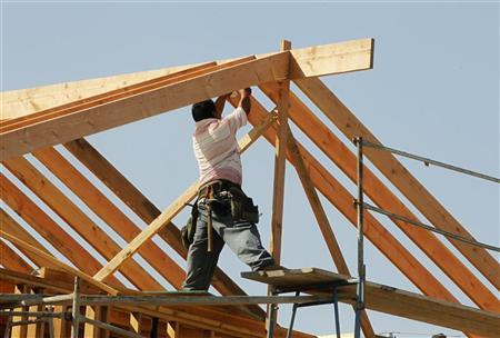 A construction worker works on the framework for a single family home currently under construction in Los Angeles in this October 18, 2011 file photo. REUTERS/Fred Prouser