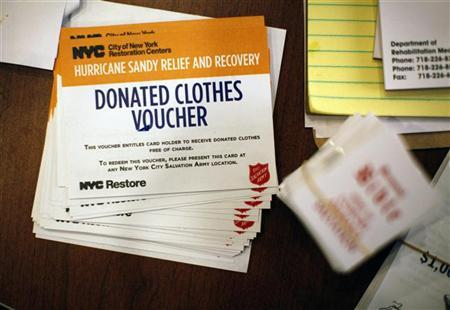 New York City donations vouchers sit on a table at the Oasis Christian Center in the Midland Beach area of Staten Island, New York, November 14, 2012. REUTERS/Brendan McDermid