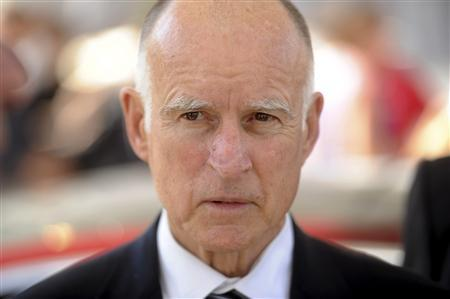 California Governor Jerry Brown attends a celebration at Tesla's factory in Fremont, California, in this June 22, 2012 file photo. Brown is undergoing treatment for early stage prostate cancer, and has an excellent prognosis, his office said on December 12, 2012. REUTERS/Noah Berger/Files
