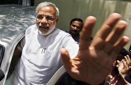 Gujarat's Chief Minister Narendra Modi gestures to the media after meeting with Bharatiya Janata Party (BJP) leader Lal Krishna Advani in New Delhi May 14, 2009. REUTERS/Adnan Abidi/Files