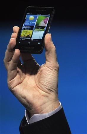 Research in Motion Chief Executive Officer Thorsten Heins holds up a prototype of the BlackBerry 10 smartphone at the BlackBerry World event in Orlando May 1, 2012. REUTERS/David Manning