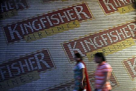 Women walk past a closed booking office of Kingfisher Airlines in New Delhi October 1, 2012. REUTERS/Mansi Thapliyal/Files
