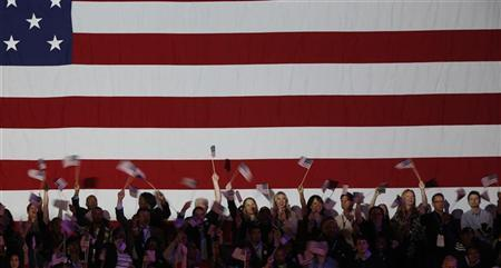 Supporters of President Barack Obama cheer during his election night rally in Chicago, November 6, 2012. REUTERS/Larry Downing