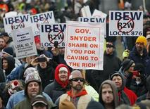 Anti right-to-work protesters gather outside of Michigan's state capitol building in Lansing December 11, 2012. REUTERS/Rebecca Cook