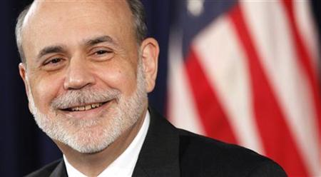 U.S. Federal Reserve Chairman Ben Bernanke smiles during a news conference in Washington December 12, 2012. In an unprecedented step, the Federal Reserve said on Wednesday it would hold interest rates near zero until it hit the specific target of a 6.5 percent U.S. jobless rate, and it pledged to keep pumping more money into the economy. REUTERS/Kevin Lamarque (UNITED STATES - Tags: POLITICS BUSINESS)