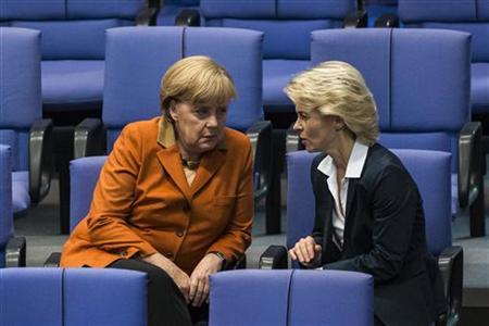 German Chancellor Angela Merkel talks with Labour Minister Ursula von der Leyen during a session of the Bundestag, the German lower house of parliament, in Berlin October 18, 2012. REUTERS/Thomas Peter (GERMANY - Tags: POLITICS)